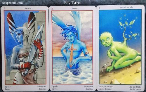 Fey Tarot: 7 of Swords, 3 of Swords, & Ace of Wands.