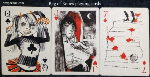 Bag of Bones: Queen of Clubs, Jack of Hearts, & 7 of Diamonds.