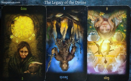 The Legacy of the Divine: 5 of Coins, 5 of Swords reversed, & 6 of Cups reversed.
