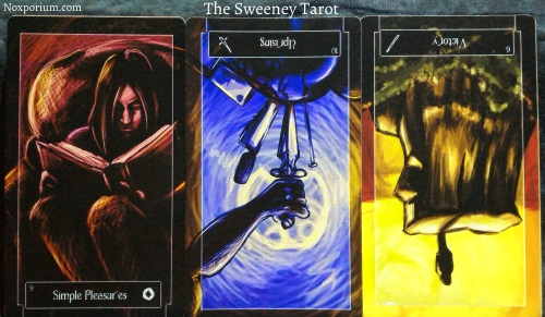 The Sweeney Tarot: 9 of Coins, 10 of Swords reversed, & 6 of Wands reversed.