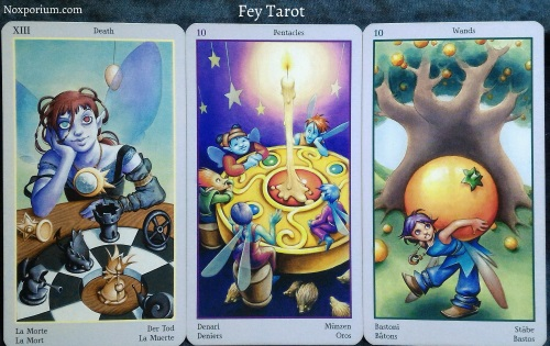 Fey Tarot: Death, 10 of Pentacles, & 10 of Wands.