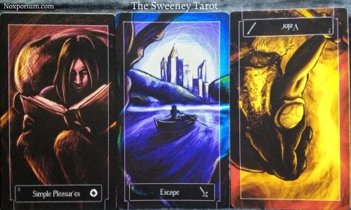 The Sweeney Tarot: 9 of Coins, 6 of Swords, & 7 of Wands reversed.