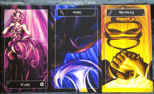 The Sweeney Tarot: 10 of Coins, 5 of Swords reversed, & 3 of Wands reversed.