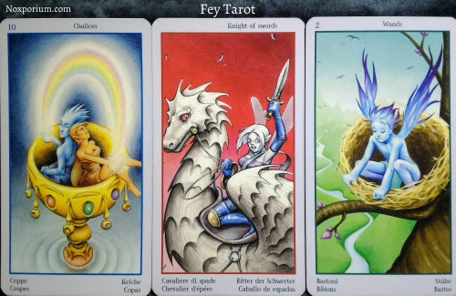 Fey Tarot: 10 of Chalices, Knight of Swords, & 2 of Wands.