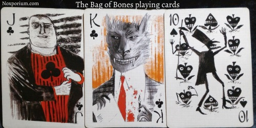 Bag of Bones playing cards: Jack of Clubs, King of Clubs, & 10 of Spades.
