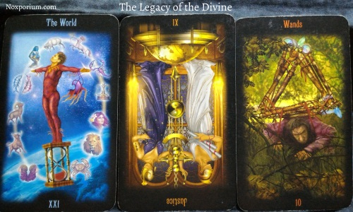 The Legacy of the Divine: The World, Justice [XI] reversed, & 10 of Wands.