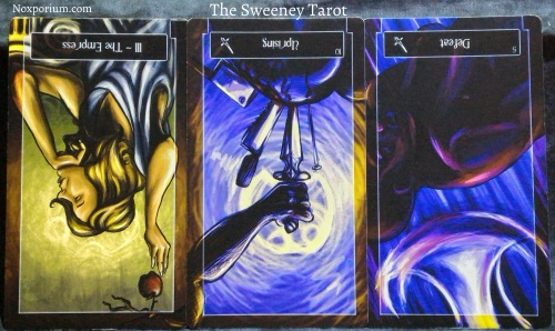 The Sweeney Tarot: The Empress reversed, 10 of Swords reversed, & 5 of Swords reversed.