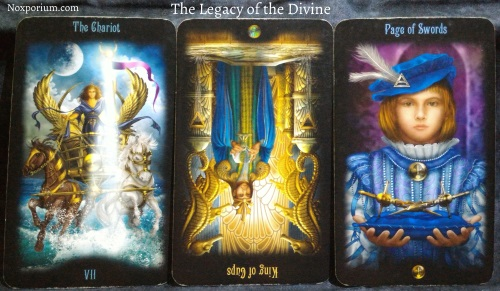 The Legacy of the Divine: The Chariot, King of Cups reversed, & Page of Swords.