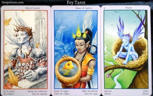 Fey Tarot: King of Swords, Knave of Chalices, & 2 of Wands.