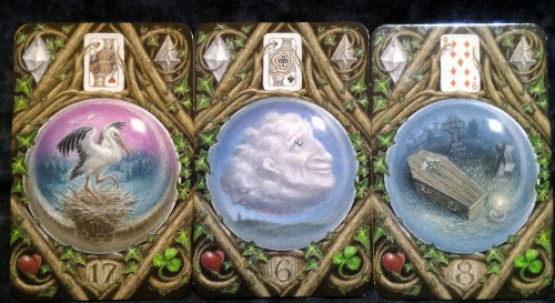 The Enchanted Lenormand Oracle: Stork + Clouds + Coffin.