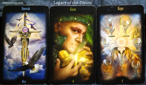 The Legacy of the Divine: Ace of Swords, 4 of Coins, & 7 of Cups.