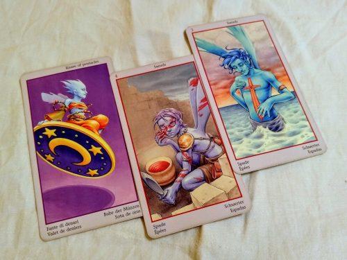 Fey Tarot: Knave of Pentacles, 4 of Swords, & 3 of Swords.