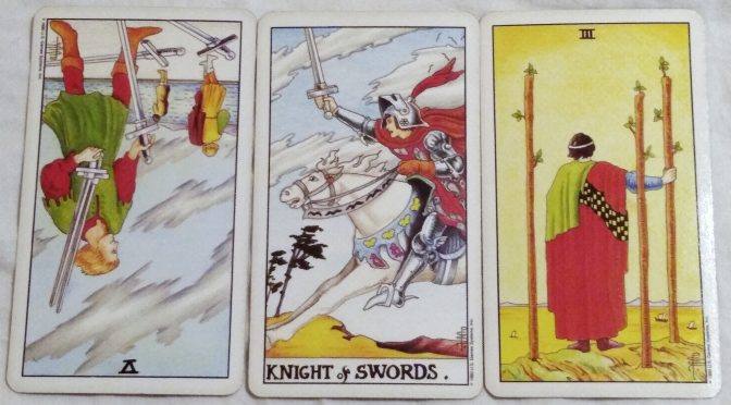 Universal Waite: 5 of Swords (reversed), Knight of Swords, & 3 of Wands.