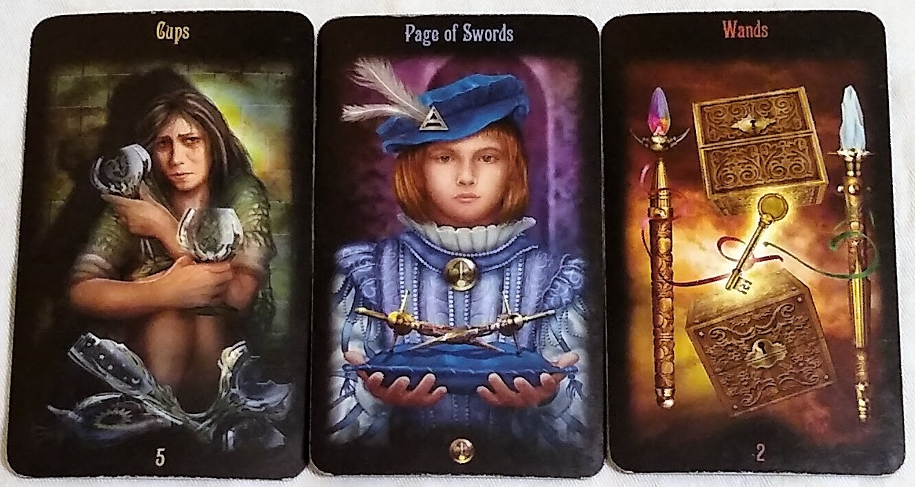 Legacy of the Divine: 5 of Cups, Page of Swords, & 2 of Wands.