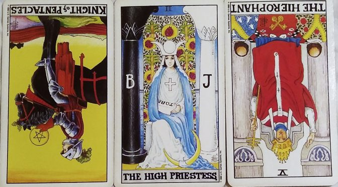 The Universal Waite Tarot: The Knight of Pentacles (reversed), The High Priestess [II], & The Hierophant {V] (reversed). ©US Games Systems