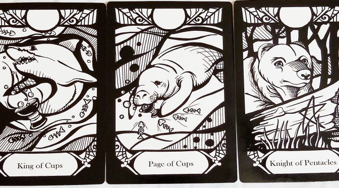 Animalis Os Fortuna: King of Cups, Page of Cups, & Knight of Pentacles.