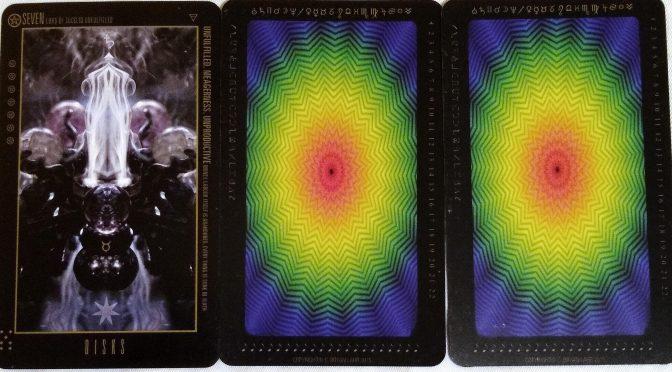 Wyzard of Odd: Seven of Disks, (unknown), & (unknown).