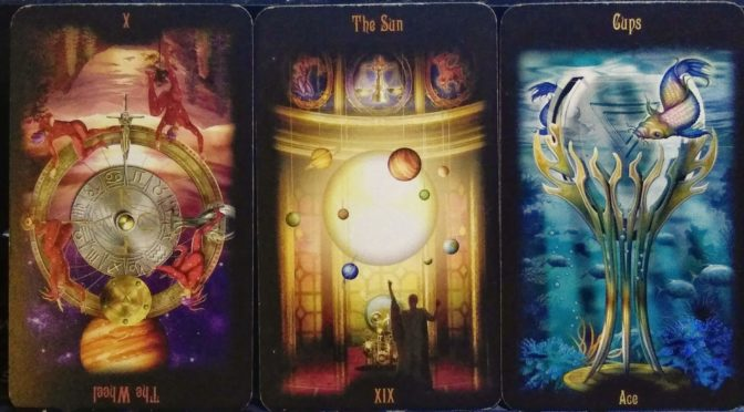 Legacy of the Divine: The World [X] (reversed), The Sun [XIX], & Ace of Cups.