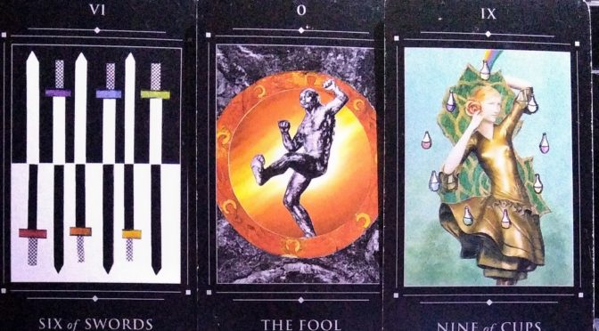 Red Magician Tarot: Six of Swords, The Fool [0], & Nine of Cups.
