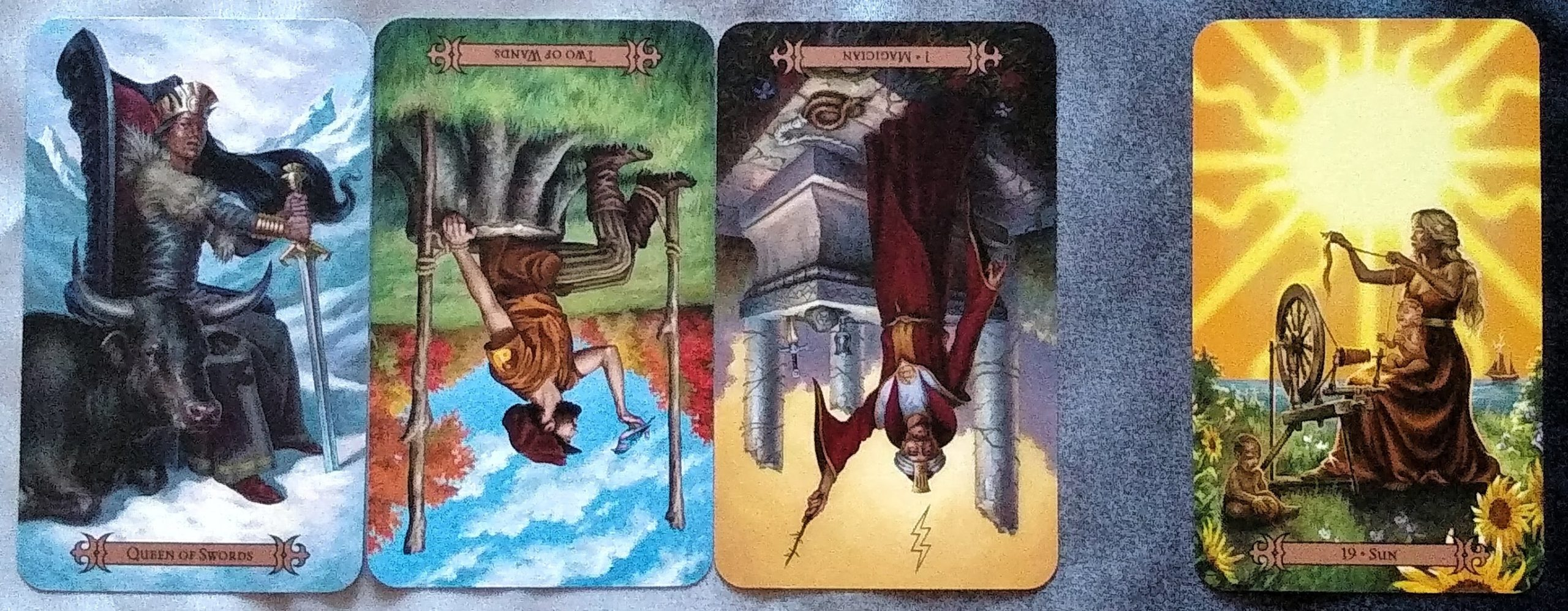 Modern Spellcaster's Tarot: Queen of Swords, Two of Wands (reversed), Magician [I] (reversed), and Sun [XIX].