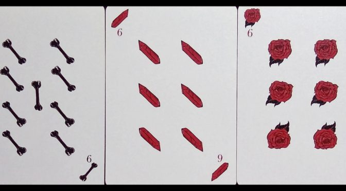 Corvid Romantic Playing Cards: 9 of Bones, 6 of Crystals, & 6 of Roses.