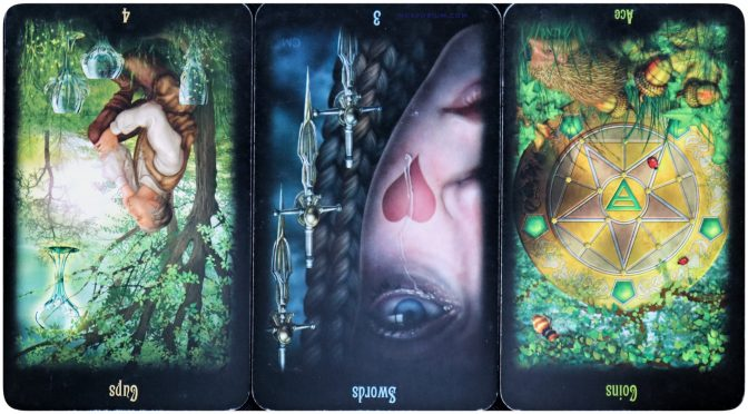 Legacy of the Divine: 4 of Cups (reversed), 3 of Swords (reversed), & Ace of Coins (reversed). ©Llewellyn Worldwide.