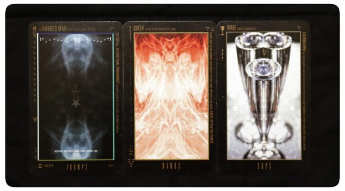Wyzard of Odd: The Hanged Man [XII], Queen of Wands, & Three of Cups. ©Bryan Lahr.